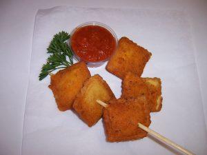 Deep-fried ravioli on a stick