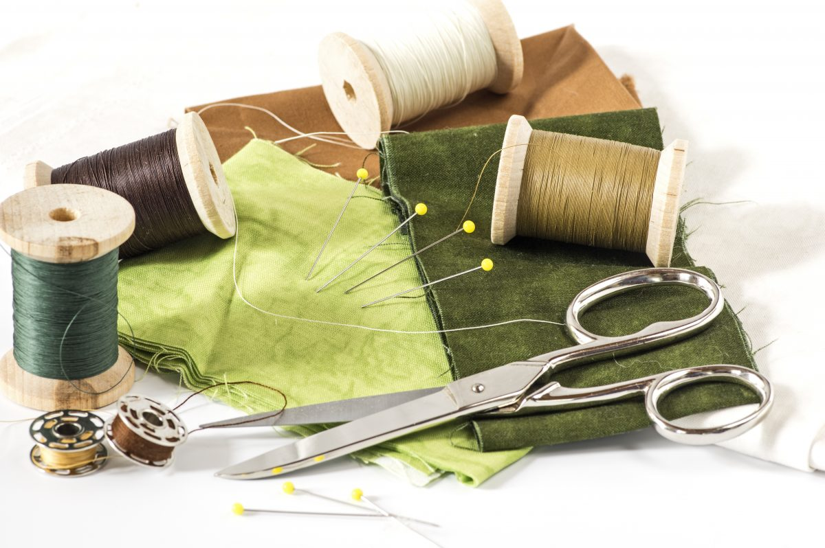 Some sewing Tools and green fabric and thread